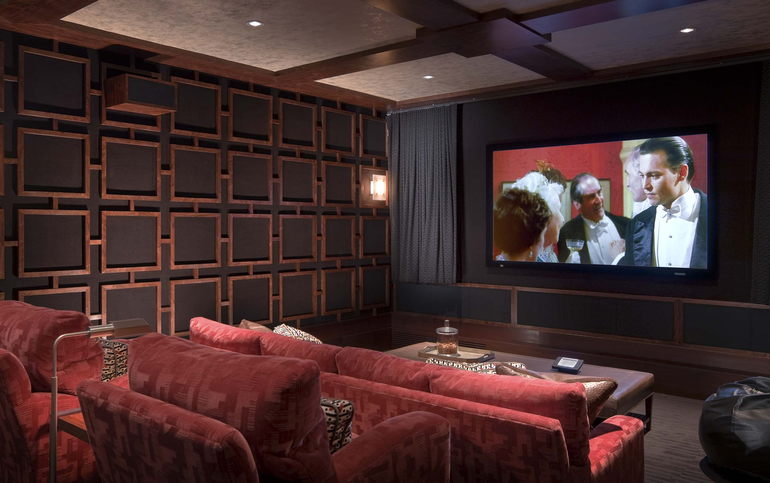 home theater with wood detailed walls